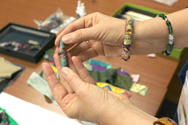 Lauren Kingsland assists the creation of bracelets for patients and staff members