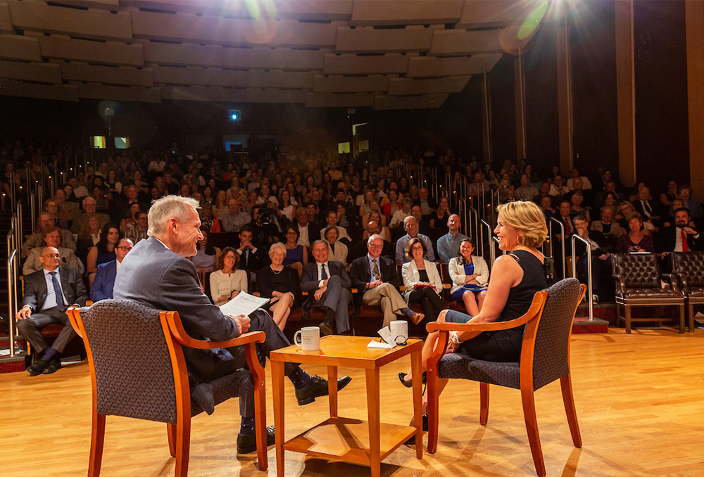 Dr. Marshall and Katie Couric sit onstage with an audience before them