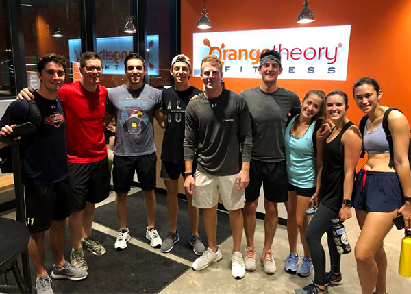 A group of people post-workout at Orangetheory Fitness