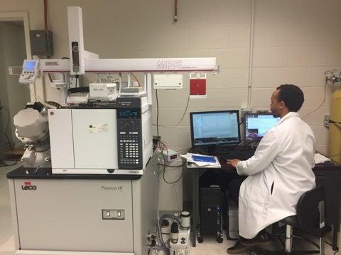 Person using lab instrument