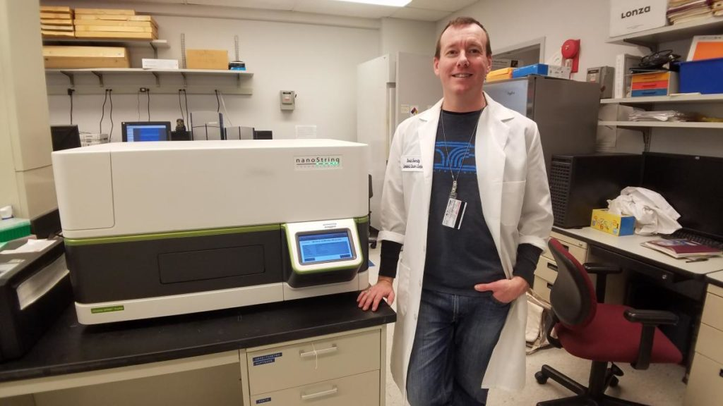 NanoString nCounter with male lab researcher