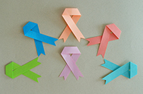 Different color ribbons represent survivors of different types of cancer