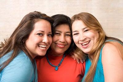 3 smiling latina women
