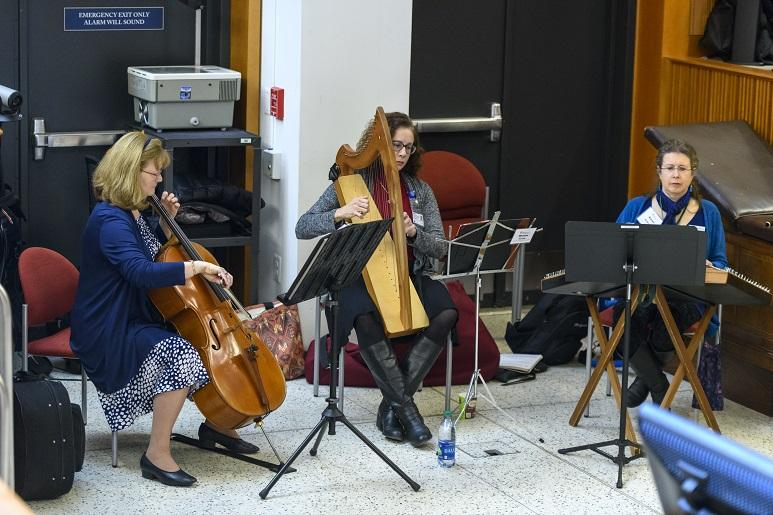 The Georgetown Lombardi Arts and Humanities Program musicians-in-residence (from left to right) Martha Vance, cello, Miriam Gentle, harp, and Karen Ashbrook, hammered dulcimer provide music for the Music as Medicine Symposium, March 2018