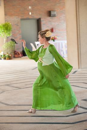 Dancer in green, flowing dress.