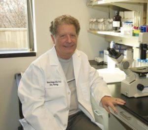 Dr. Richard Schlegel sits in his lab