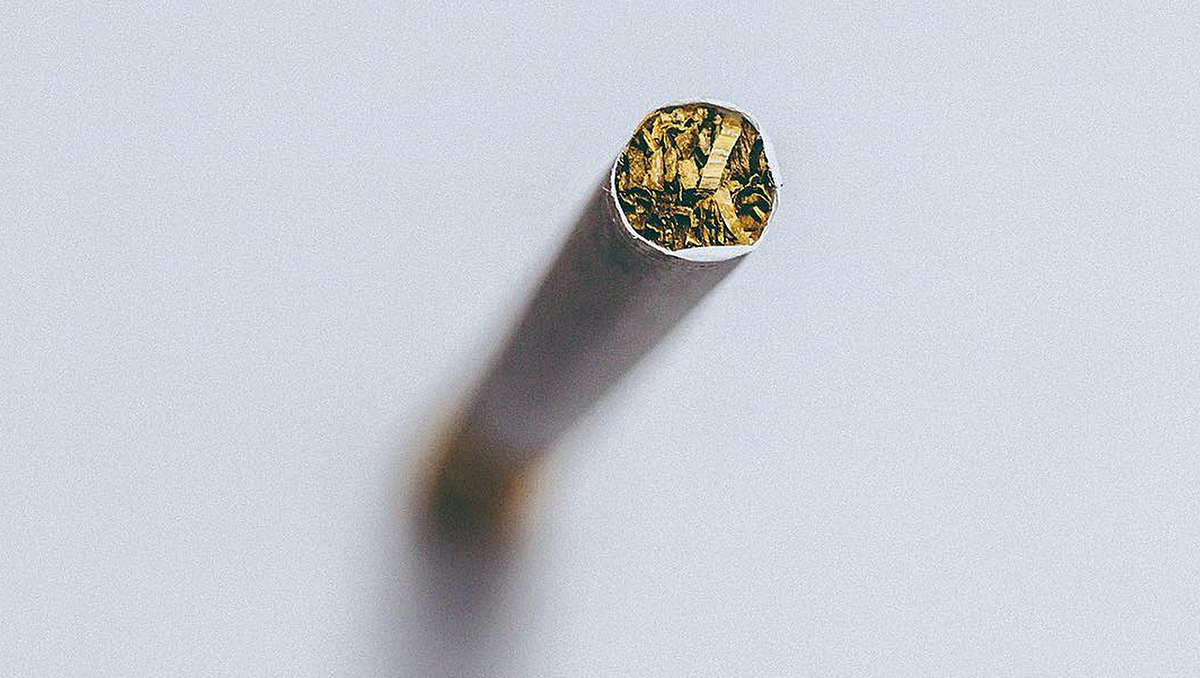 A cigarette pictured from one end
