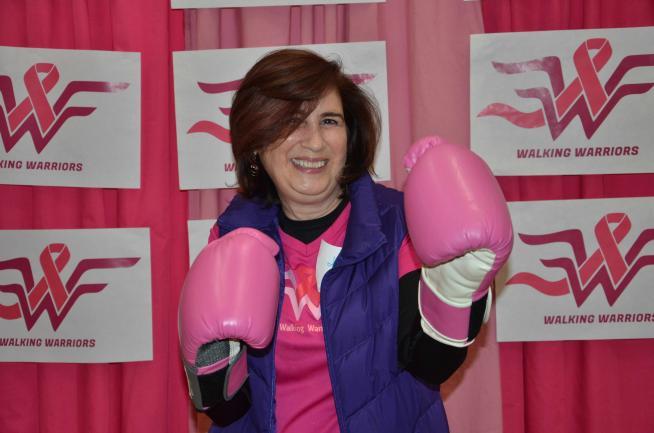 Jeanne Mandelblatt wears pink boxing gloves in celebration of the Walking Warriors debut