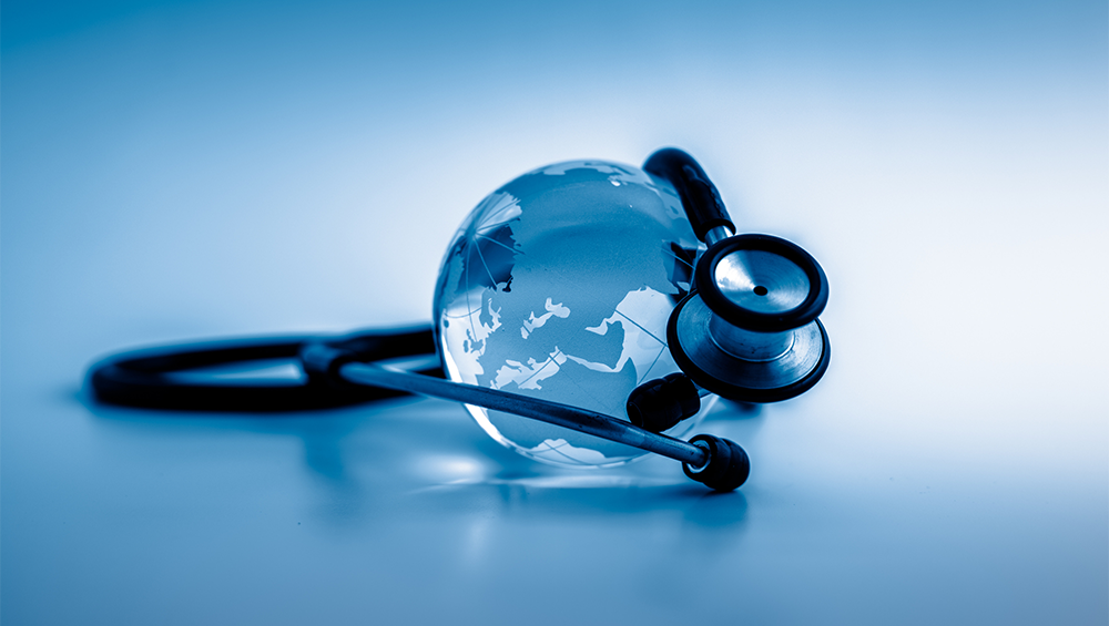 Photo illustration of a globe with a stethescope wrapped around it