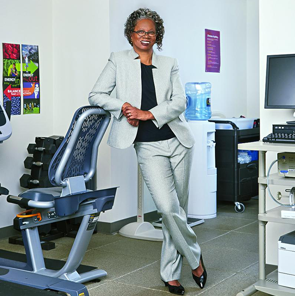 Lucile Adams-Campbell stands amid exercise equipment in a lab setting